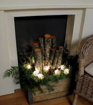 Use an old crate filled with logs, greens, pine cones, and lights (LED they stay cool) ...This would look great on the porch, by the front door, or anywhere you want.