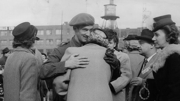 This shows a man hugging his mother after he returns home from World War 2. This is a credible source because it was taken at the time of the event. This shows Canadian lives changing because soldiers are coming home and Canadian lives are going back to the way they were before the war.