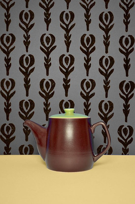 Brown ceramic teapot.