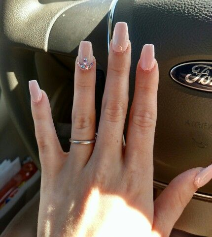Nude pink nails with Swarovski Crystal design. Square tips