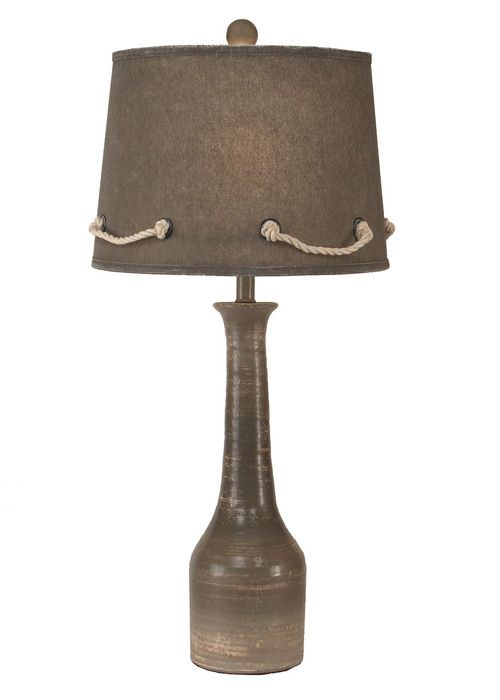 Dark and Stormy, this nautical lamp is highlighted with a grey shade looped with off-white rope and metal rivets.