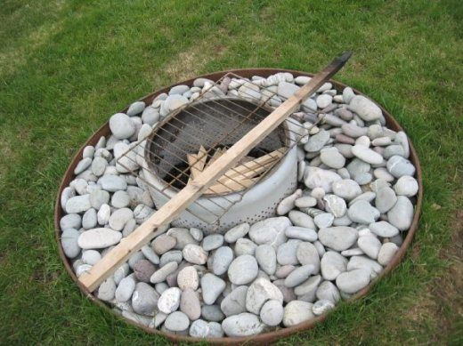 old washing machine drum fire pit  -- an old RV-ers trick; our neighbors have been doing this for years on the driveway during our block parties