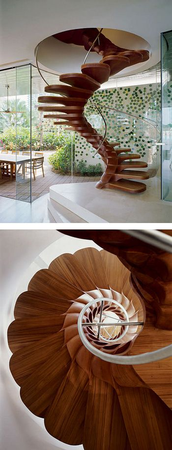 This spectacular wooden sprial staircase is just a tiny part of the 3,000m2 lavish contemporary homestead designed by Jouin Manku of Paris architectures YTL Design Group.
