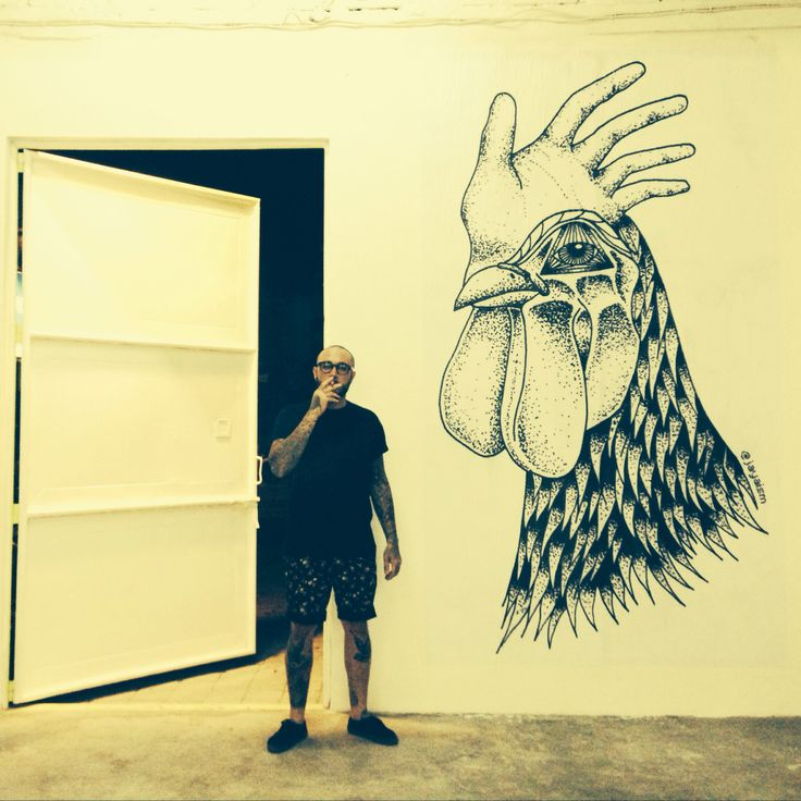 Large paste up of Bruce the Rooster at Warehouse 82 in Bali, Indonesia.