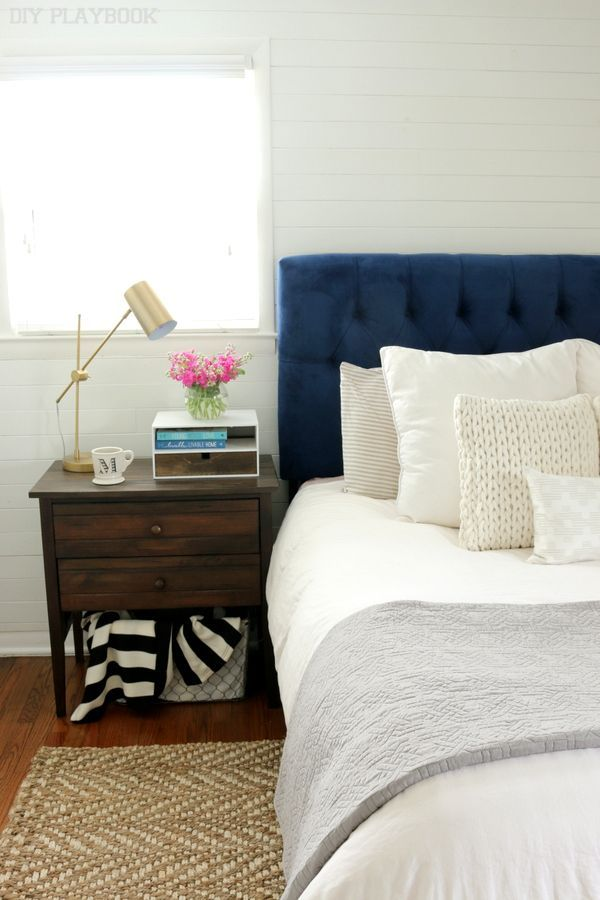 Looking for a simple bedroom design idea? Make your headboard the star of the show, then build accent decor around it. You can't go wrong with something tufted and bold in color. Add texture with rugs, woods and accents. And of course a gold lamp always adds more glam.