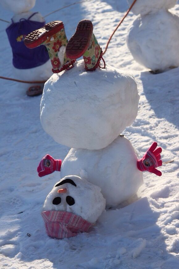 Funny snowman! Winter snow Christmas snowman drunk upside down