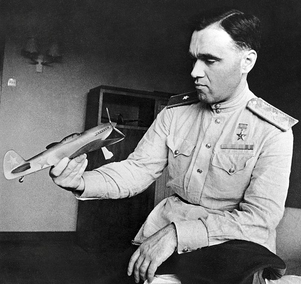Alexander Sergeyevich Yakovlev (1906-1989), Soviet aircraft designer, in military uniform and holding an aircraft model. Photographed in Moscow, Russia, in 1943.