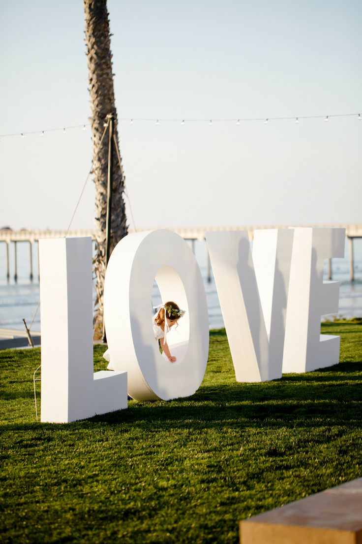 Giant LOVE Letters -- See the wedding on #SMP here: http://www.StyleMePretty.com/2014/04/30/black-white-blush-seaside-wedding/ Photography: Ashlee Raubach Photography - www.ashleeraubach.com