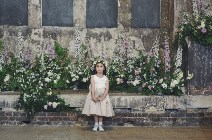 Wedding flowers by Jennifer Pinder a florist based in Kent London. A wild hedgerow style arrangement in lilac and white at the asylum in Peckham London