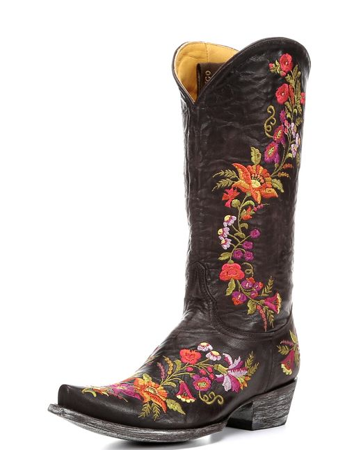 """The 13"""" Jasmine Boot is signature Old Gringo style: time-honored craftsmanship and vivid embroidery. Intricate floral details glow against the rich chocolate leather, while the outsole and heel are carefully distressed. The 13"""" shaft height is perfect for your cutest sundress. Every Old Gringo boot is handcrafted through a 130-step process and held to the highest quality standards. Liven up your wardrobe with the Jasmine boot!"""