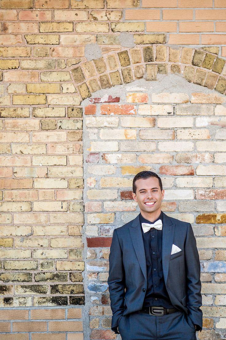 Brick Background, Stone background, Gray suit, white bowtie, Rustic, Beautiful, Unique, Wedding venues, Handsome groom, Hacienda Sarria, Kitchener, Waterloo, Cambridge, Ontario, Canada wedding photography experts | Anne Edgar Photography