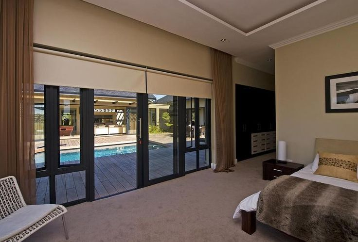 Main bedroom leads out onto the glass enclosed entertainment deck