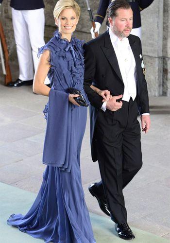 Gustaf Magnusson, primo de la novia y su bella esposa, Vicky Andren
