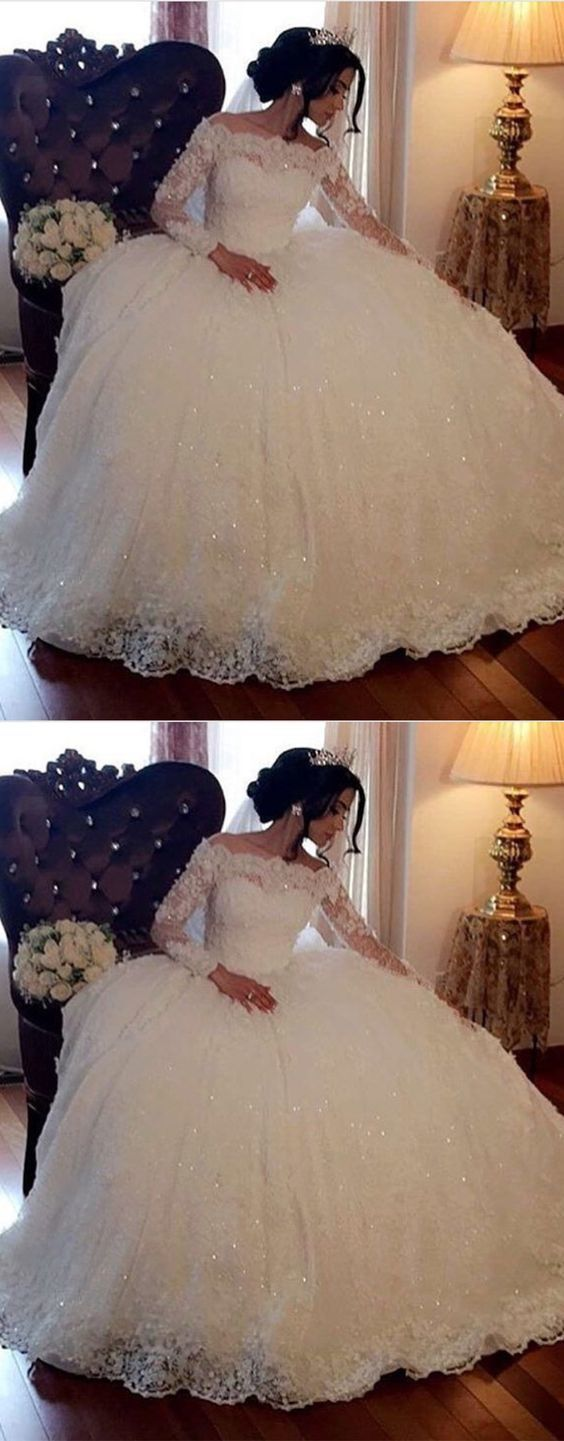 Long-sleeved lace wedding dress with beadwork