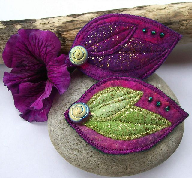 Felt Leaf Brooches Cerise, Lime Green and Purple    These sumptuous leaf shaped brooches are made with hand dyed merino fibre and hand dyed silk. Beautiful shades of deep purple and fuchsia pink are mixed with a little gold to make these really eye catching.