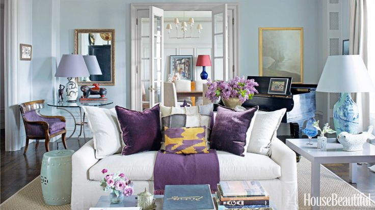 In the living room of this Manhattan apartment, designer Alexander Doherty painted the walls painted Pavilion Gray, and the trim is Lamp Room Gray, both from Farrow & Ball. A blue-and-white Qing dynasty lamp and a 20th-century painting by Michael McGuigan, behind the piano, reflect the owners' wide-ranging connoisseurship. Throw by Frette.