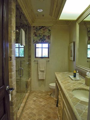 Tiled bathroom with an enormous shower