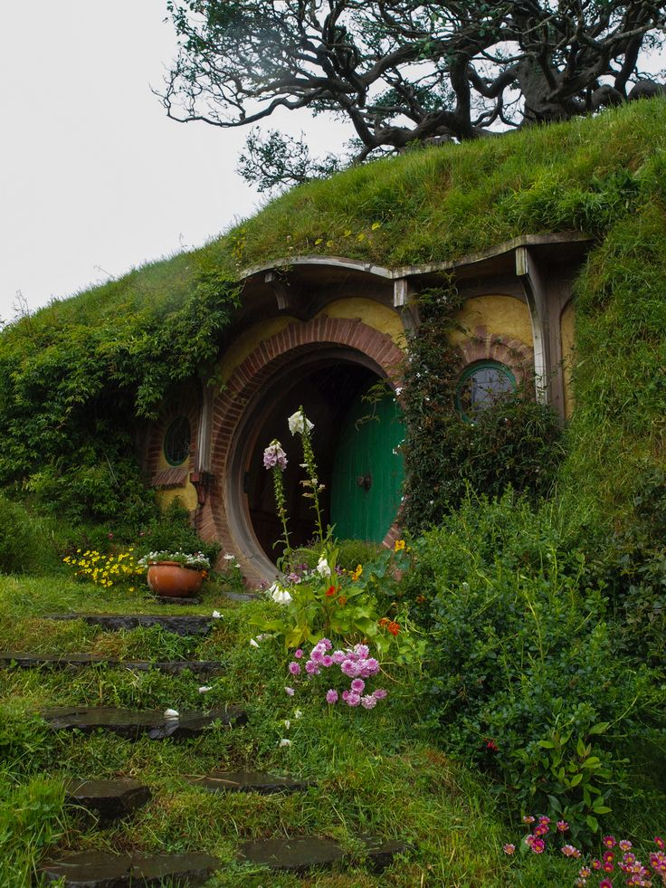 Maybe this is what we should do to the odd corner of our property...build a hobbit house!  Can you imagine?!: