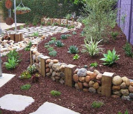 This retaining wall was built using recycled chicken wire, pebbles and wooden nogs