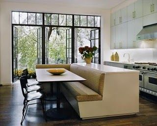 very cool and modern kitchen/dining room. This would be great for a loft