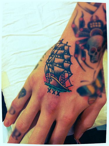 I like the tatoo... I don't know if I would want it on my hand though.