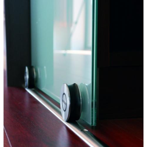 Floor mounted sliding door track for glass doors