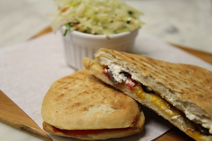 Mediterranean panini with goats cheese, cooked peppers and olives