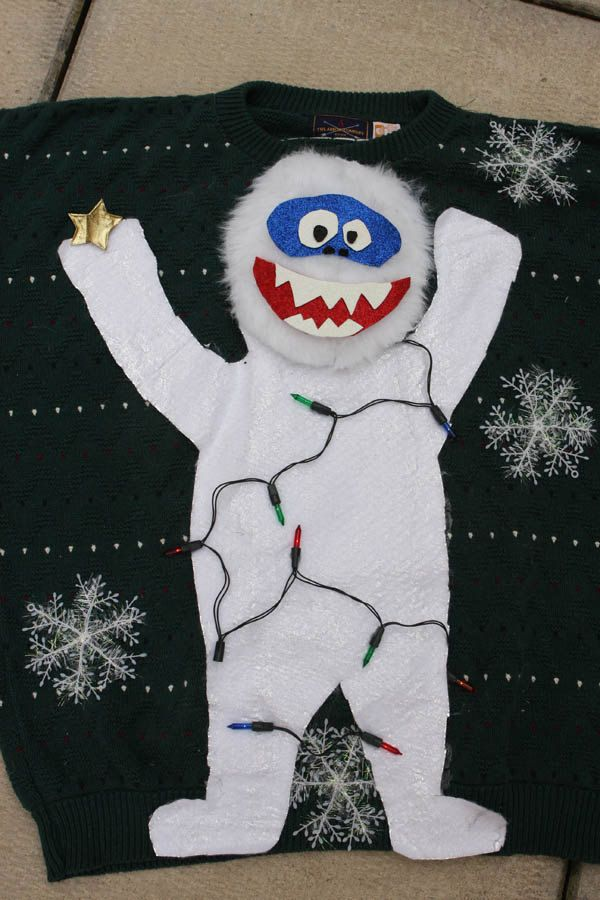 Abominable Snowman with REAL LIGHTS Ugly Christmas Sweater from etsy. For more creative inspiration, see loads of funny ugly Christmas sweaters at www.myuglychristmassweater.com