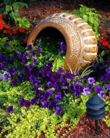 Don't throw out broken or chipped pots. Bury the broken part and plant flowers in the opening.