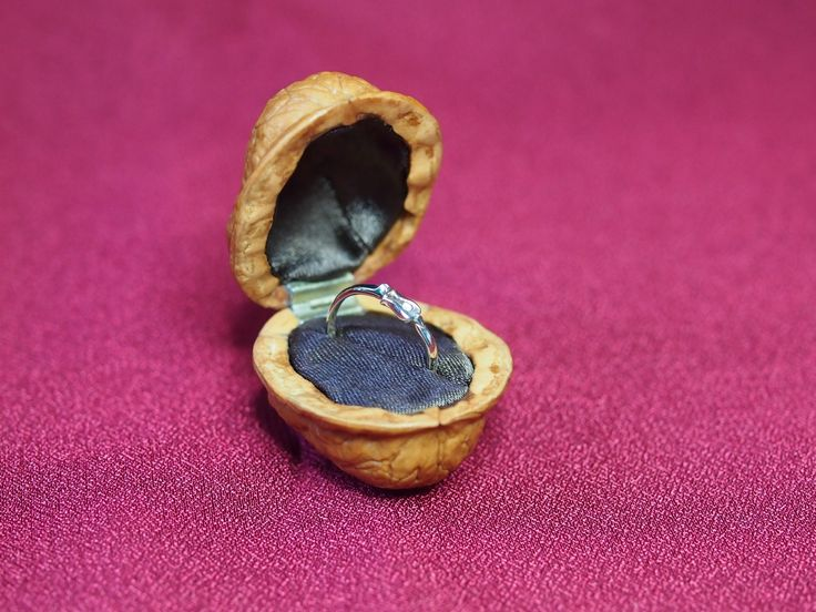 Handmade walnut shell ring box. The inside is lined with brown damask, custom-made hinges and magnetic lock's installed.