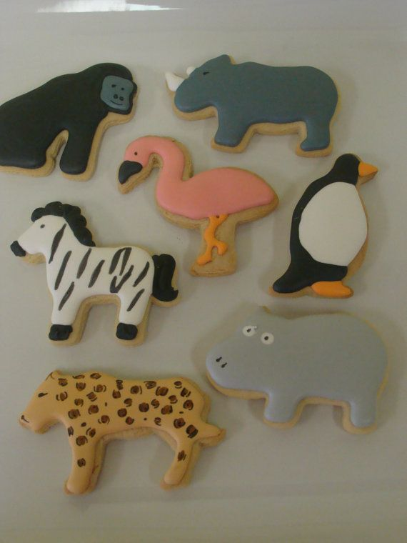 Set of zoo animals comes with two of each animal shown: gorilla, flamingo, rhino, hippo, zebra, penguin and cheetah. Great to take along to