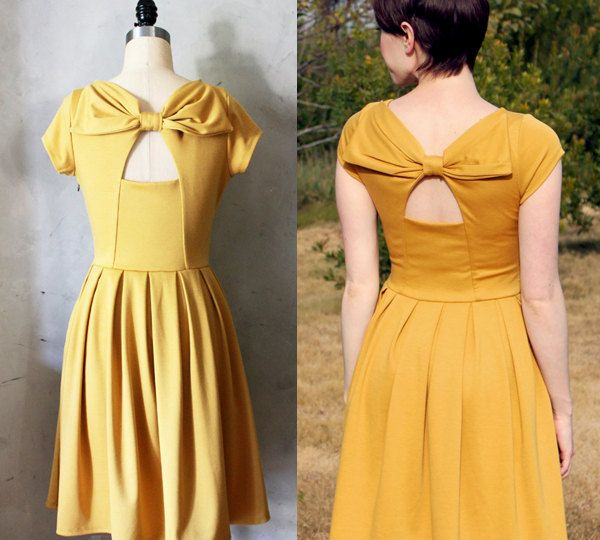 HOLLY GOLIGHTLY MUSTARD - Yellow dress with pockets // pleated skirt // back cut out // bridesmaid dress // vintage inspired // party // day.  via Etsy.