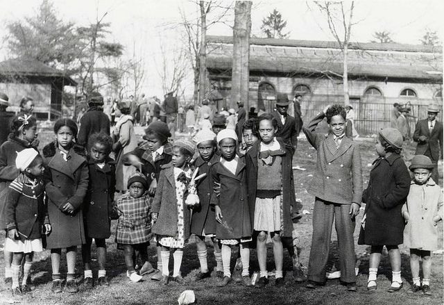 Bunny Hop | 1936    African American children in their Easter Monday best in front of the Lion House Addition at the National Zoo, Washington D.C., 1936. Smithsonian Institution Archive