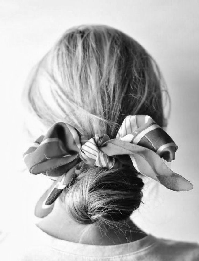 low messy bun with a scarf as a bow.
