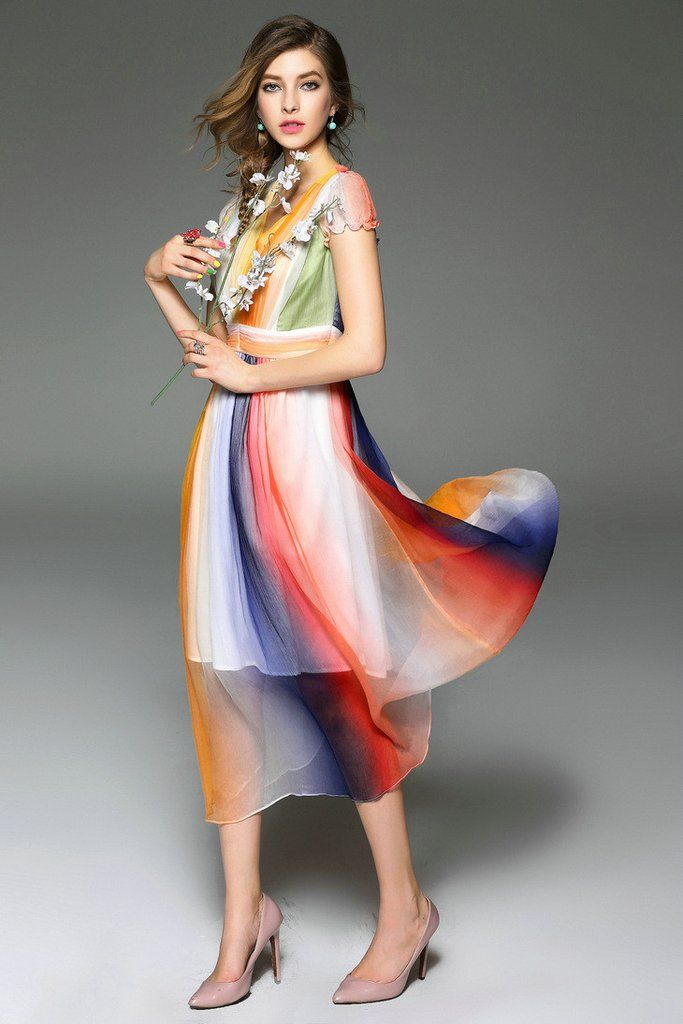 Summer Lovin' cascading color-blocked panels add a sophisticated finish to a rainbow on the swingy silhouette of this breezy mid-calf dress. Slips on over head