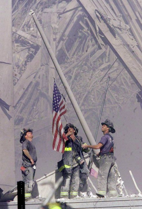 Ground Zero Spirit - One of the most famous pictures from 9/11, photo of three firemen raising the American flag at the site of the World Trade Center attacks. Shot by Thomas E. Franklin, of The Bergen Record, the photo first appeared on Sept 12, 2001 under the title, Ground Zero Spirit. The paper also put it on the Associated Press wire and it appeared on the covers of several newspapers around the world. The photo was a finalist in 2002 for the Pulitzer Prize in breaking news photography.