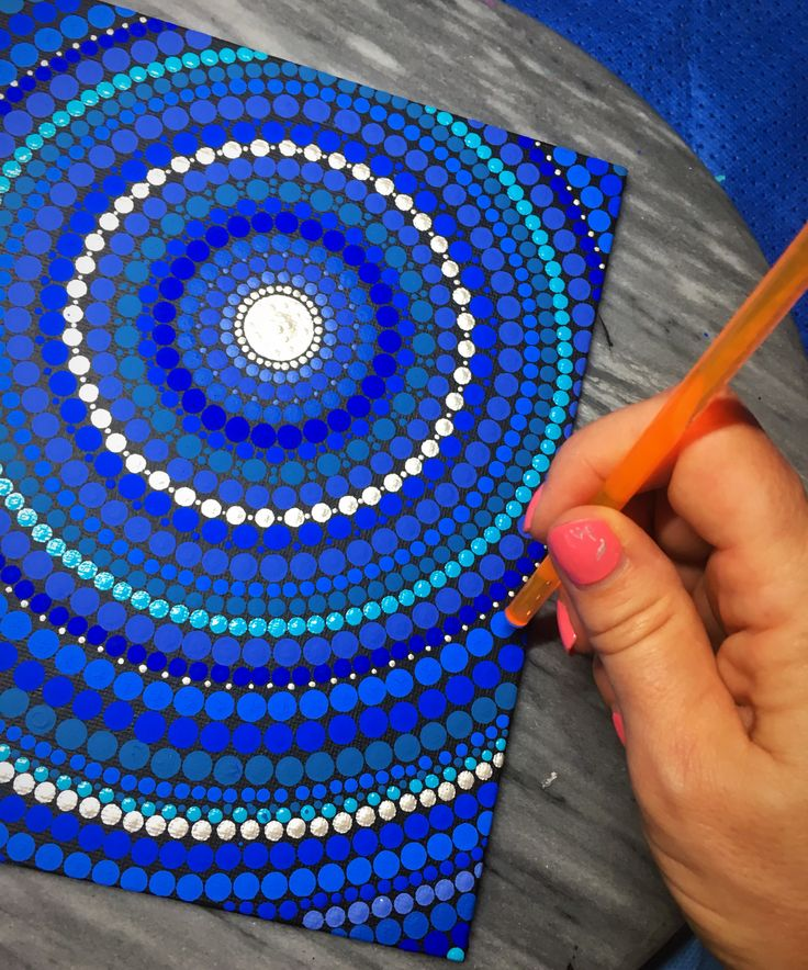 Dot painting using Happy Dotting Tools. Making perfect dots is what it's all about!  These tools are precision cut to make beautiful dots. #dottingtools #dotillism #dotpainting #mandala #pointillism #happydottingcompany