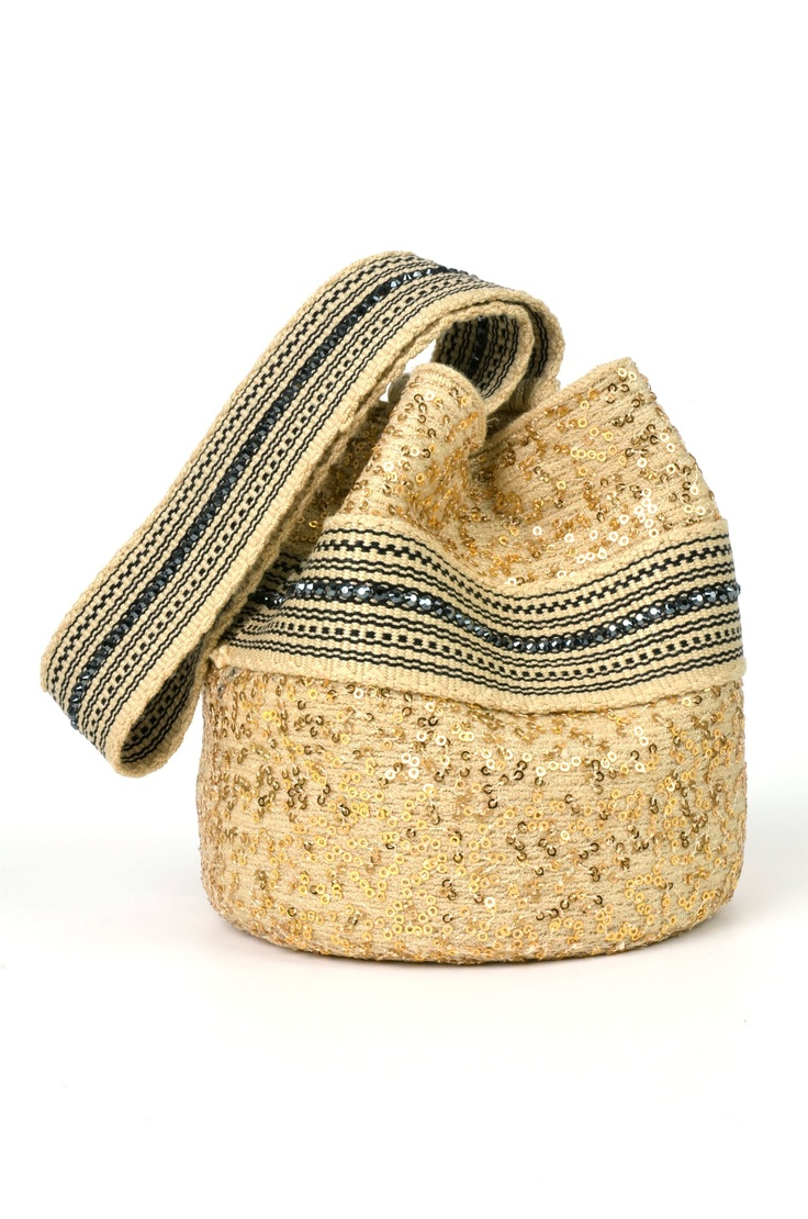 Mochila, The bag par excellence.  Everyone owns one! This one here though, is an alternative version of an indigenous handmade one, made by one of our best designers, Silvia Tscherassi, for her collection inspired by the Wayuu tribe. (It's crystallized with Swarovski crystals!)   #SilviaTcherassi #Wayuu