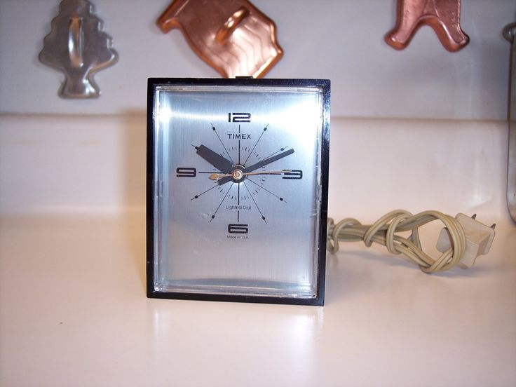 Vintage Timex alarm clock in black with lighted silver face by MaAndPasAttic on Etsy