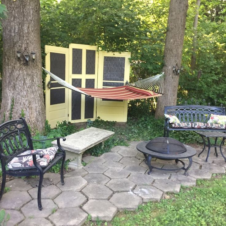 Turn Screen Doors into Backyard Privacy  I've seen this idea in a neighbor's yard, not repainted or modified because they used old inside doors as a backdrop for an outdoor sitting area.