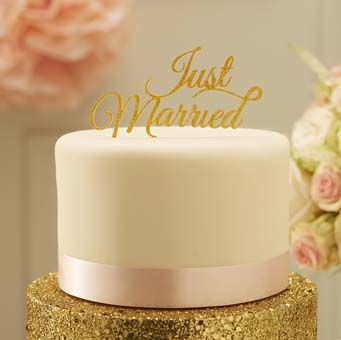 """Top your special wedding cake with this stunning gold sparkle """"Just Married"""" cake topper."""