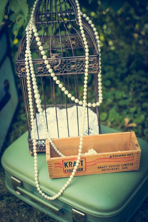 Beautiful birdcage and pearls.