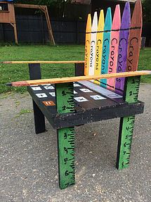 http://palletdad.wixsite.com/palletdad Chair has crayons, pencils, rulers, even a calculator! Great for a classroom, playroom, or library. #furniture #homemade #chair #backtoschool