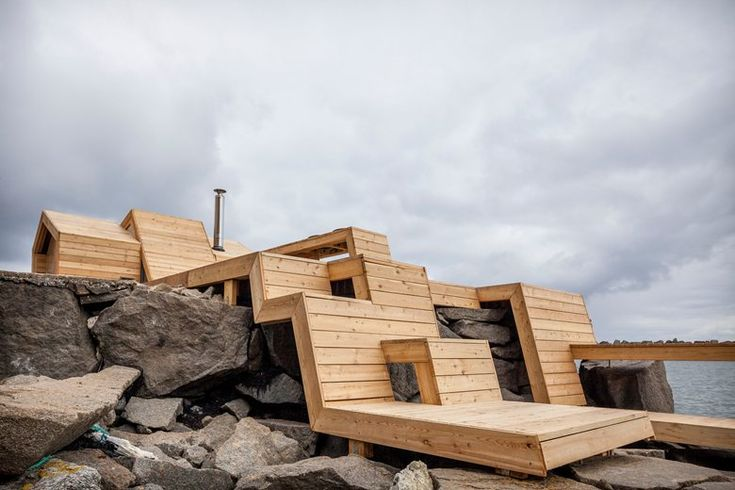 The project is located in Kleivan, north of the Polar Circle, in an archipelago formed by an 1100 m high wall of mountains and cliffs that stretches 250 kms. into the North Sea. The site is on a quay containing three existing buildings: a...