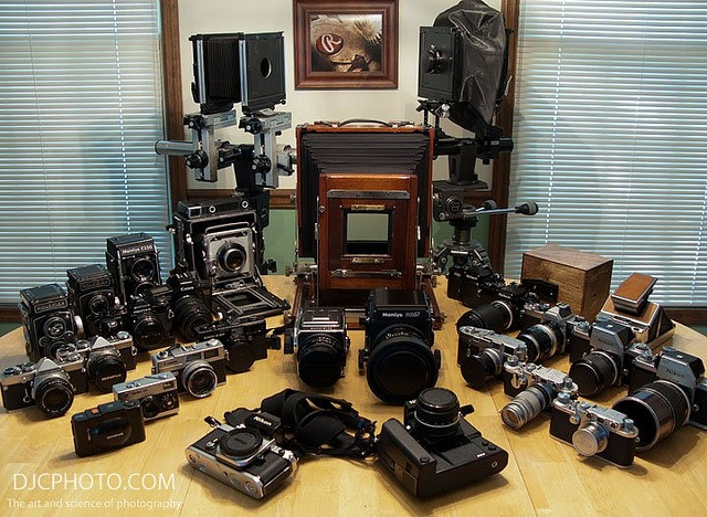 This lot, plus a load of lenses for the various systems (not shown), has cost me less than half the price of a Nikon D3x! Pretty amazing, and, yes, I use each and every one of them.      Brand name (Camcorders|Film Cameras|Printers|Scanners|Digital Cameras) cheap! Learn More at http://gettysburgcirclemall.com/?nid=502394