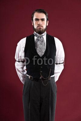 Retro 1900 Victoriaanse mode man met baard, gekleed in zwarte gilet