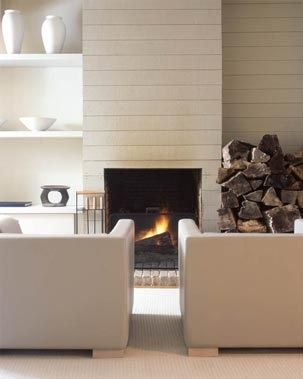 another wood clad fireplace, painted with a summer cottage look