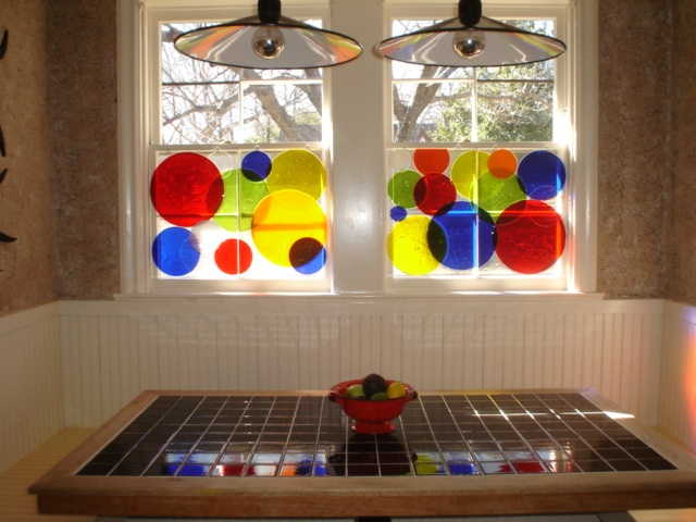 Custom privacy panels.  Each panel can be easily removed to clean windows or to change out. By Barbara Draughon