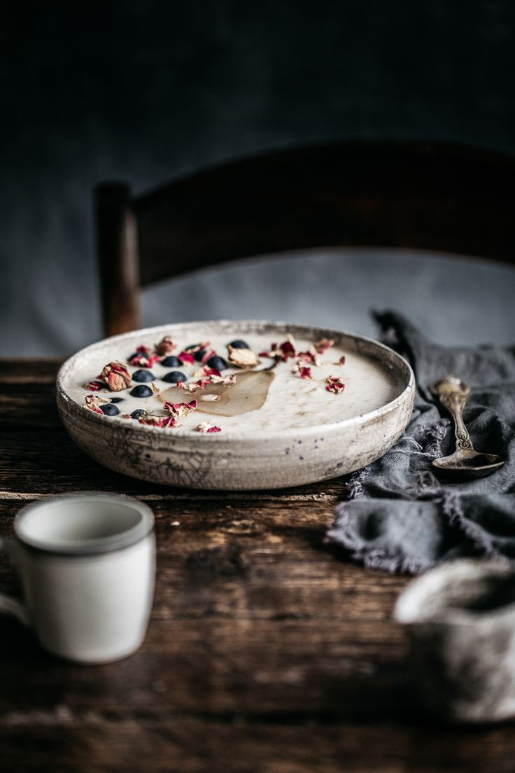 Creamy chilled porridge topped with chia poached pears and a serious lug of maple syrup! Porridge you can enjoy, even in the heat of Summer! Anisa Sabet   The Macadames   Food Styling   Food Photography   Props   Moody   Food Blogger   Recipes