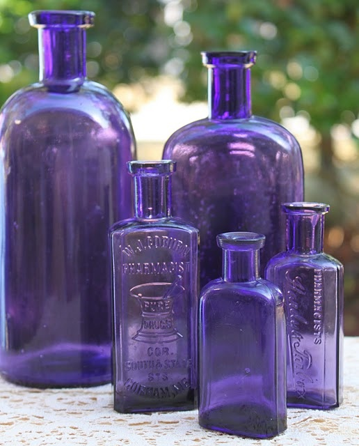 """Sun colored amethyst or """"purple glass"""" bottles, c.1880 to WWI. These look beautiful in a window or on a white shelf."""